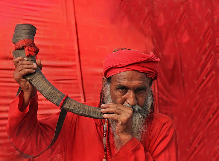 A saint In Red From Sufi Shrine Of Madhu Lal Hussain