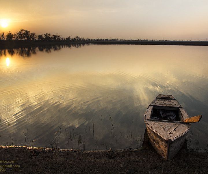 Parked Boat In Golden Light Of Winter Evening