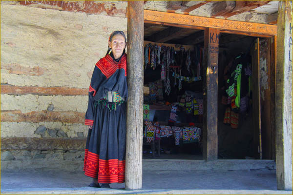 Kalash Woman Running a Shop of Handicraft