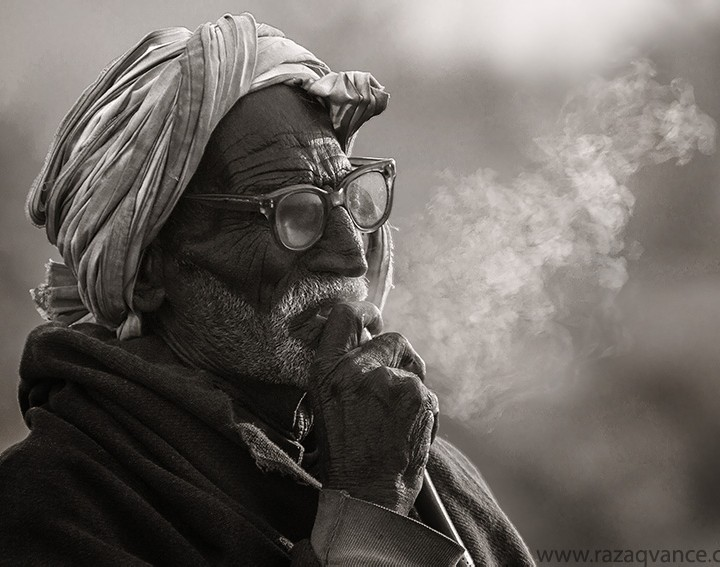 BLACK AND WHITE PORTRAIT OF A FARMER FROM ASIA